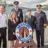 From left to right: Cdr Clive Butler, Vancouver City Counsellor Melissa De Genova, Constable Blair Da Costa, HLCol Allen De Genova, and Fire Chief Tim Armstrong pose for a photo before departing the ship.