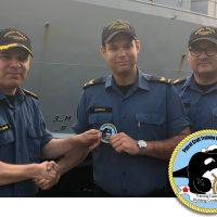 LS Nicholas Dipersio (centre) presents the unit's new morale patch that he designed to LCdr Tyson Bergmann, Patrol Craft Training Unit (PCTU) Commanding Officer, and CPO2 Eric Pohoney, PCTU Coxswain.