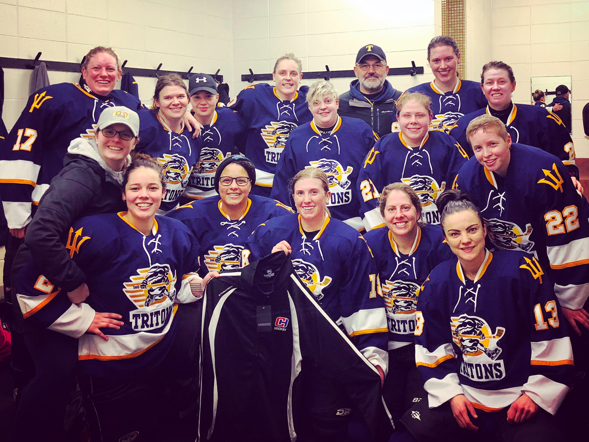 The Women's Tritons hockey team are all smiles in their team's dressing room after winning the CARHA Pacific Cup championship game at Oak Bay Arena on Jan. 20.