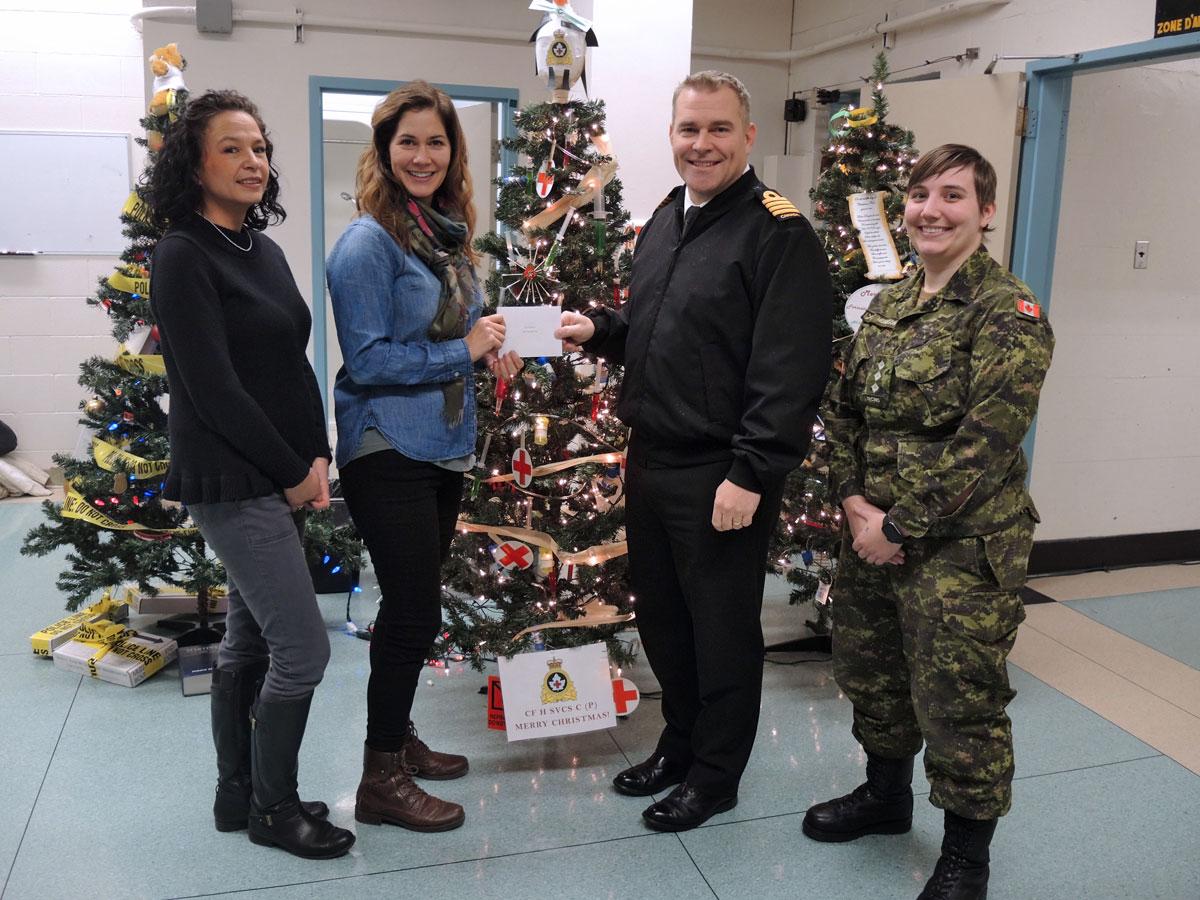 Best Griswold Tree, Canadian Forces Health Services Centre (Pacific): (Left) Terri Yuen, Sgt Shauna Karnes, Base Commander, Capt(N) Jason Boyd, and Capt Kelsie Morrison.