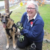 Nine-year-old German Shepard Miss Moxxii and her handler Angela Lavergne show off the special commemorative puck they will use in the ceremonial opening puck drop for the Victoria Royals Defence Appreciation Night at the Save On Foods Memorial Centre on Nov. 15. Photo by Peter Mallett/Lookout