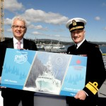 Larry Sullivan from Rogers' Chocolates, and RAdm Nigel Greenwood officially launch the navy chocolate bar.