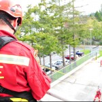 Firefighter Mark Walker takes in the sights during a high line exercise at the CFB Esquimalt Fire Department, Oct. 8.