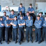 Members of HMCS Unicorn take a moment in the K158 Annex boatshed after a busy training exercise.