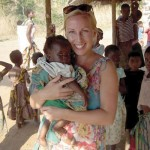 Robyn Los cuddles an orphan at the Kondanani Orphanage in Malawi, Africa.
