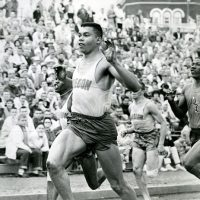 Harry Jerome crosses the finish line at a dual meet with the University of Oregon and Oregon State University, circa 1961.