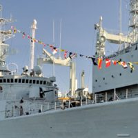 HMCS Algonquin is all dressed for 50th anniversary of the National Flag of Canada.