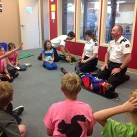 Cadets Alexandra Saumure and Goldie Beckett (playing the casualty) learn first aid strategies from Callum Elsdon-McLeod (far left), main instructor Leanne Wood, and Shawn Beckett.