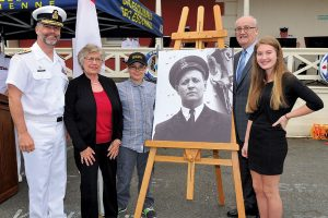 A portrait of Chief Petty Officer (CPO) Max Bernays is unveiled during the naming announcement of the third Arctic/Offshore Patrol Ship, held at the CFB Esquimalt Naval and Military Museum. From left: Rear Admiral Bill Truelove, Commander Maritime Forces Pacific/Joint Task Force (Pacific); Marilyn Bernays, daughter-in-law of CPO Bernays; Max Thompson, great-grandson of CPO Bernays; Julian Fantino, Associate Minister of National Defence; and Carly Bernays, great-granddaughter of CPO Bernays. LS Ogle Henry, MARPAC Imaging Services