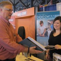 CORCAN booth at the trade show.