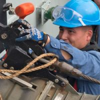 A Boatswain on board HMCS Winnipeg, disconnects the fuel connection after a Replenishment at Sea evolution with United States Naval Ship Arctic in the Eastern Atlantic Ocean during Exercise Trident Juncture.