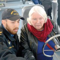 PO1 Albert Van Akker, HMCS Malahat Penelope Tew receives some driving instruction from Leading Seaman Manuel Dussault-Gomez during HMCS Malahat's annual Family Appreciation Day. Photo by PO1 Albert Van Akker, HMCS Malahat