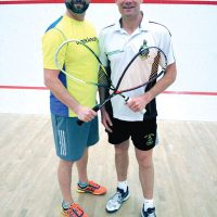 Peter Mallett, Lookout PO1 Timothy King of Fleet School welcomes Colour Sergeant Richard Hall, of the Royal Marines Commando Training Unit, Exeter, England, to Naden Athletic Centre on May 9. Squash players from the base battled their rivals from abroad in a one-day, eight match tournament.