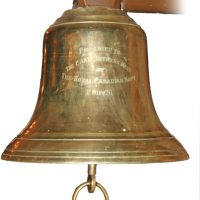 """Photo courtesy of 3 CFFTS The infamous """"Rivers Bell"""", a bell that once sat in the Officers' Mess at RCAF Station Rivers, now resides in the Officers' Mess at Portage La Prairie, as seen in 2008."""