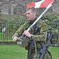 Naval Cadet In Training, Graham Mater of the Royal Military College carries the Canadian flag at the Sandhurst Military Skills competition at West Point, N.Y., April 9.