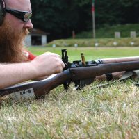 Canadian Ranger Master Corporal Adam Glover, of Gillam Patrol in Manitoba, pulls back on the bolt of his Lee Enfield .303 rifle during marksmanship training at Heals Range in Victoria, BC. Photo by Capt Chris Poulton, Public Affairs