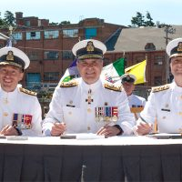 From the left: Rear-Admiral Gilles Couturier, Vice-Admiral Ron Lloyd, and Rear-Admiral Art McDonald sign Change of Command Certificates. Photo by Leading Seaman David Gariépy