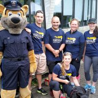 From left to right, SLt Leblanc, MCpl Edwards and PO2 Nilsson from MPU Esquimalt; Lt(N) Joiner; and Capt Harris of Canadian Forces National Investigation Service Pacific Region participate in the Victoria Law Enforcement Torch Run.