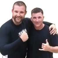 LS Thibault poses with Major Steve Burgess, Senior Combatives Instructor/Tournament Director, at the Garrison Petawawa Combatives Grappling Championships which raised $2,500 to date for the Soldier On program. Photo courtesy of LS Thibault