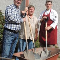 HeroWork founder Paul Latour (left), HeroWork Project Manager Peter Smither and CPO2 (Ret'd) Roxanne 'Rocket' Ogden get their shovels and wheelbarrel ready ahead of a massive renovation project of the Esquimalt United Church Rainbow Kitchen. Photo by Peter Mallett, Lookout