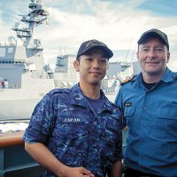 Ensign Yusuke Hara meets Commander Clive Butler during a CrossPol exercise while Vancouver transits in company of Japanese Maritime Self-Defense Force ship Fuyuzuki.