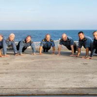 HMCS Charlottetown's Chiefs (from left to right) CPO2 Kent Ellerbeck, CPO2 Robert Embree, CPO2 Dave Skinner, ship's Coxswain CPO1 Anthony Greig Bishop, CPO2 Mathew Boniface, CPO2 Kevin Reid and MWO Mike Windsor participate in the 22 Push-up Challenge on the flight deck during OP Reassurance in the Mediterranean Sea. Photo by Cpl Blaine Sewell, Formation Imagery Services