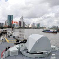 Commercial shipping traffic transits the Saigon River past HMCS Vancouver in Ho Chi Minh City, Vietnam, on Oct. 20.