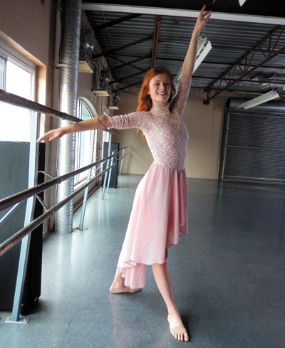 Julianna in dance mode, with her artificial arm.