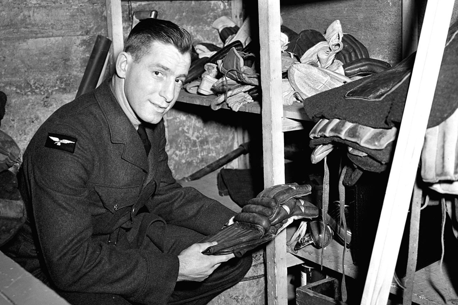 "According to the original caption to this photo, taken Feb. 25, 1942: ""Aircraftman 2nd Class Milton Schmidt is the only member of the RCAF Flyers hockey team whose duties in the Air Force are similar to his spare time job as a hockey star. The Flyers' star centre man is becoming a physical training instructor, a job for which he appears admirably fitted."" Photo: DND Archives, PL-6907"
