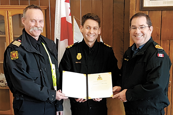 LCdr Clark Northey is joined by his father Robert Northey (left) and LCdr Trent Nichols for his promotion to his current rank and the awarding of a Canadian Joint Operations Command, Commander's Commendation.
