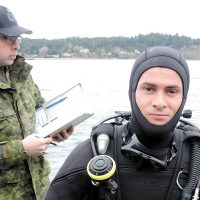 U.S. Army diver First Lieutenant Josh Voorhees prepares for a search and recovery procedure during Exercise Roguish Buoy 2017 at the Albert Head Training Centre.
