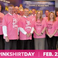 Maritime Forces Pacific leadership and DND civilian employees in D100 show their support for anti-bullying by donning the symbolic pink shirt.