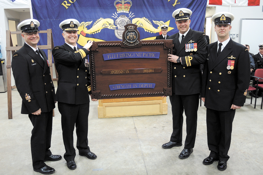 From the left: RAdm Art McDonald, Commander of Martime Forces Pacific; CPO1 Gilles Gregoire, Formation Chief; LCdr Chad Naefken, Commanding Officer Fleet Diving Unit (Pacific); and CPO1 Robert DeProy, FDU Coxswain, display the Battle Board presented at the unit's Theatre Honours ceremony Feb. 28. The unit's Clearance Divers were recognized for their bomb-defusing efforts in Afghanistan. Photos by Peter Mallett, Lookout Newspaper