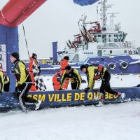 Members of the HMCS Ville de Québec ice canoe-racing team approach the finish line at the Québec Carnival Ice Canoe Race on Feb. 5. Photo by Cpl Eric Girard, Combat Camera