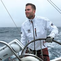 LS Spencer Baldwin is at the helm of Sea Smoke, a Bavaria 38 Cruiser, during the Route Halifax Saint Pierre Ocean Race in 2016.