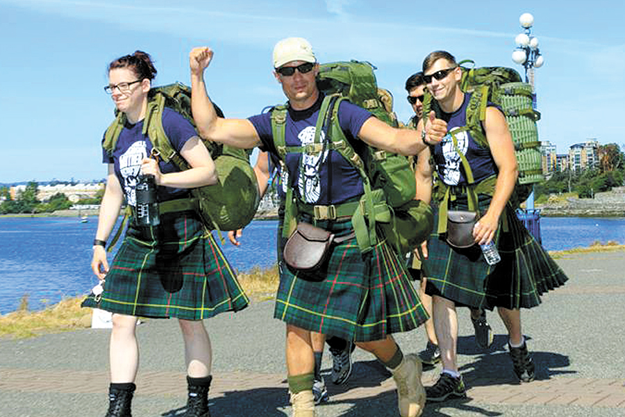 Sgt Jason Cormier gives a cheer as he and members from the Junior Ranks Mess of the Canadian Scottish embark on the 2016 Walk to Fight Arthritis.