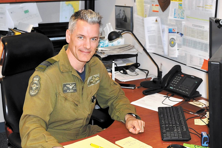 Major Justin Olsen, Officer in Charge of the Joint Rescue Coordination Centre Victoria, at his desk at CFB Esquimalt.