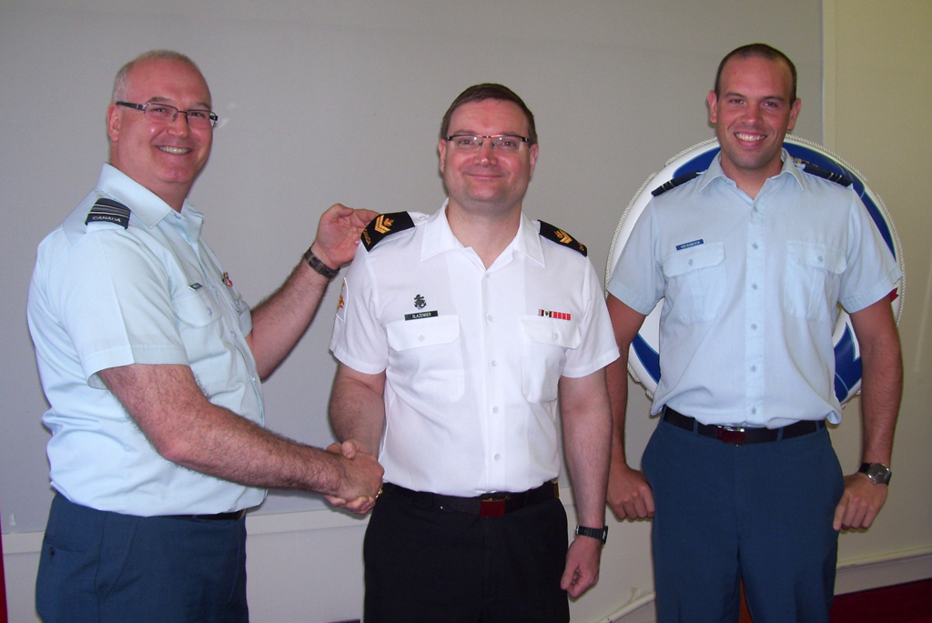 MS Solomon Slazenger is promoted to his current rank by Maj Grant Whittla (left), Acting Commanding Officer BIS Esquimalt, and Captain Joshua Weissbock, Operations Officer BIS Esquimalt.
