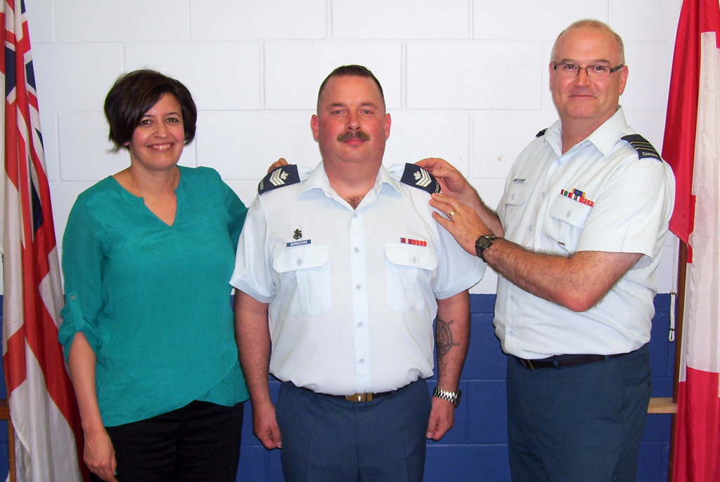 Sgt Philip Berresford is promoted to his current rank by Maj Grant Whittla, and his wife Kathy Berresford.