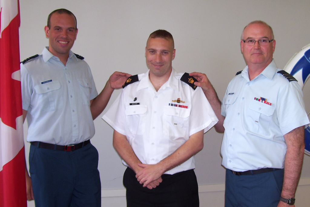 PO1 Gord McKiver is promoted to his current rank by and Captain Joshua Weissbock and Maj Grant Whittla.