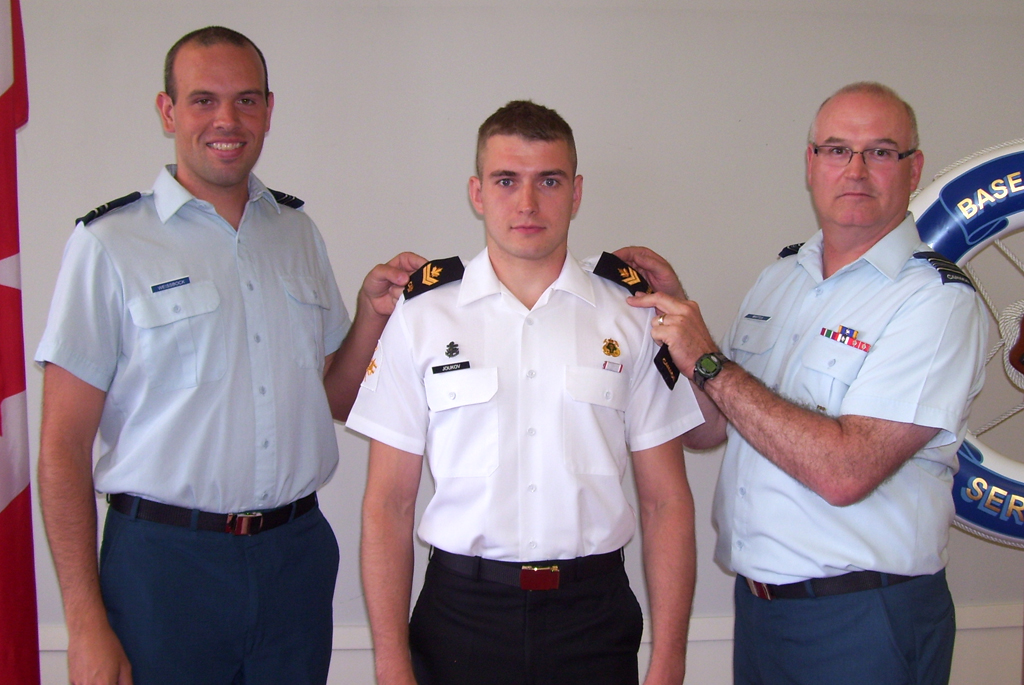 MS Mikhail Joukov is promoted to his current rank by and Captain Joshua Weissbock and Maj Grant Whittla.