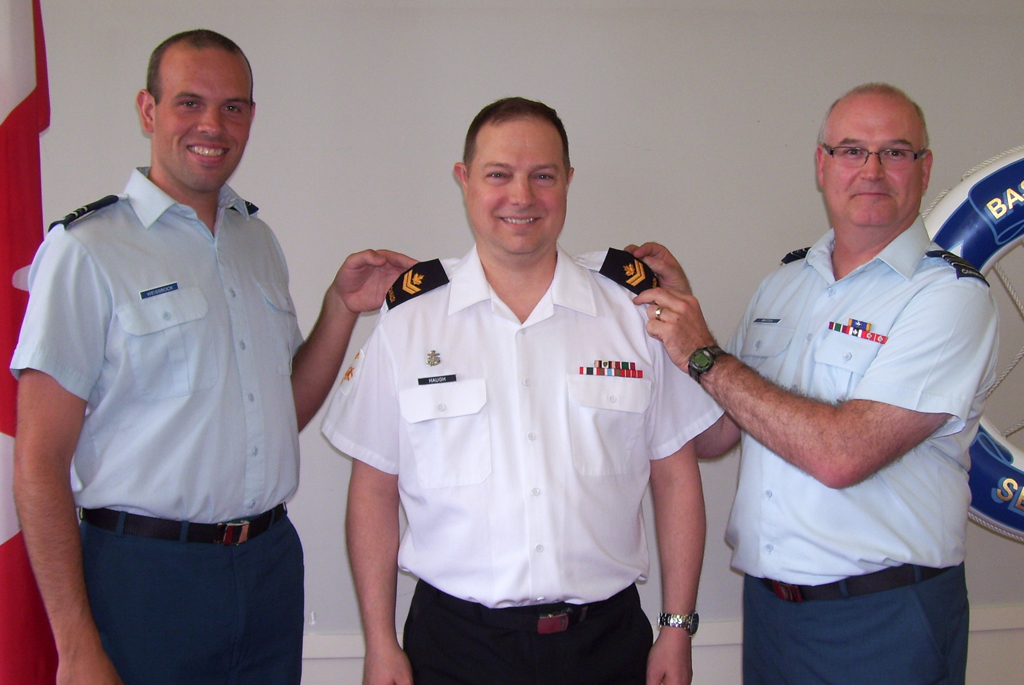 MS Bryan Haugh is promoted to his current rank by and Captain Joshua Weissbock and Maj Grant Whittla.