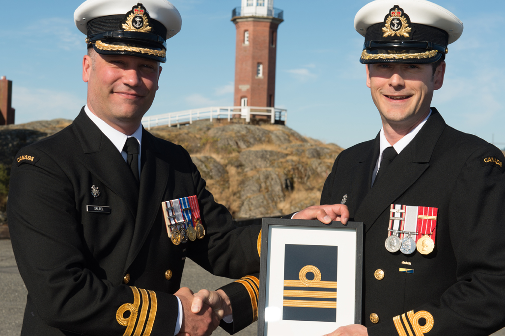 LCdr Mike Stefanson is promoted to his current rank.