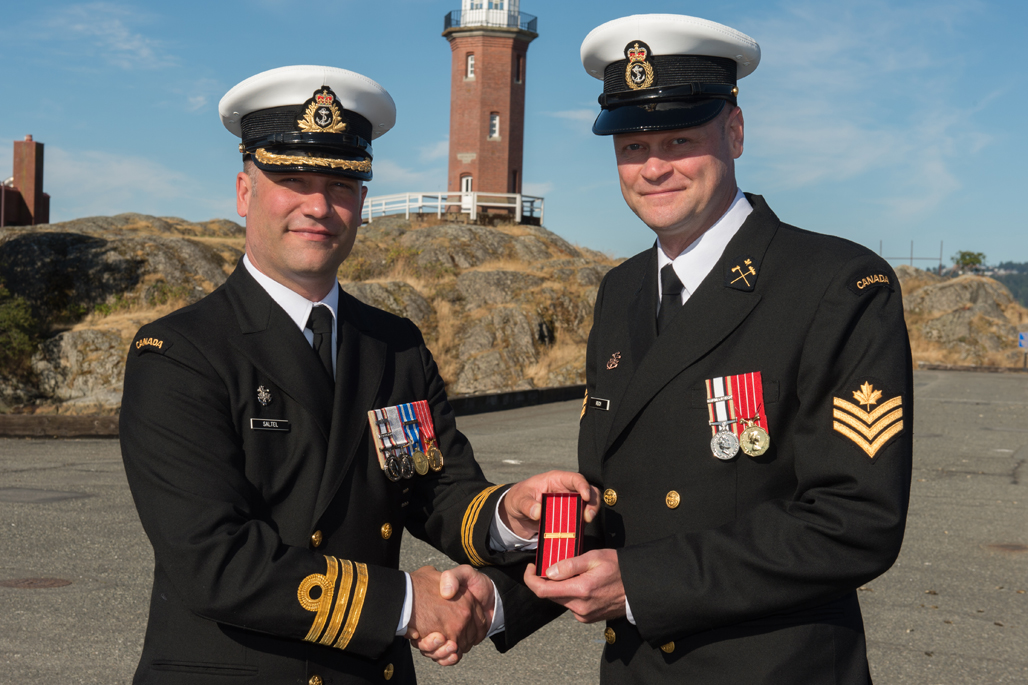 PO2 Brian Riech is presented the Canadian Forces' Decoration First Clasp.