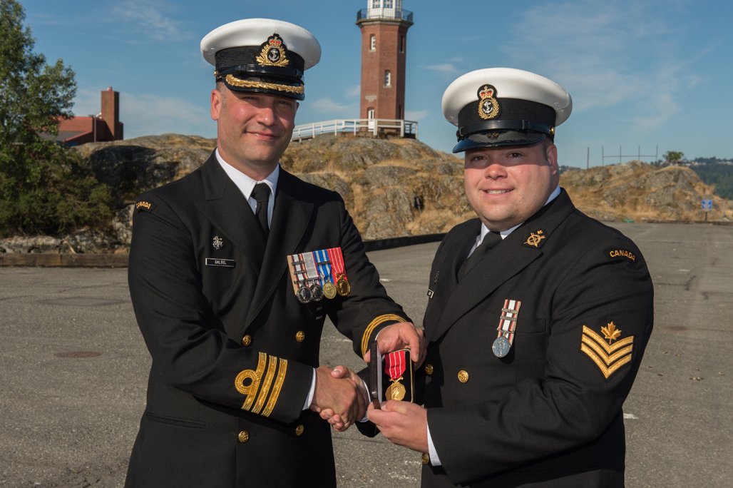 PO2 Rene Chalifoux is presented the Canadian Forces' Decoration.