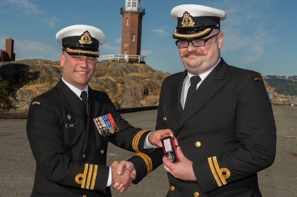 Lt(N) Adam Bailey is presented the Operational Service Medal.