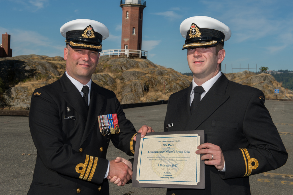 SLt Place is presented the Commanding Officer's Bravo Zulu award.