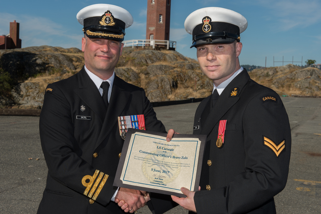 LS Adam Carnegie is presented the Commanding Officer's Bravo Zulu award.