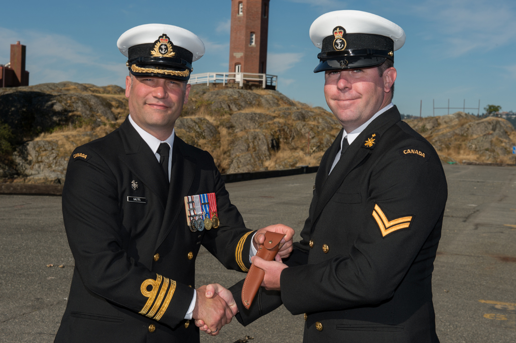 LS Matthew Cormier is presented the Sailor of the Quarter.