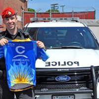 Corporal Matthew Best, Military Police Unit Esquimalt poses with a Tour de Rock jersey.